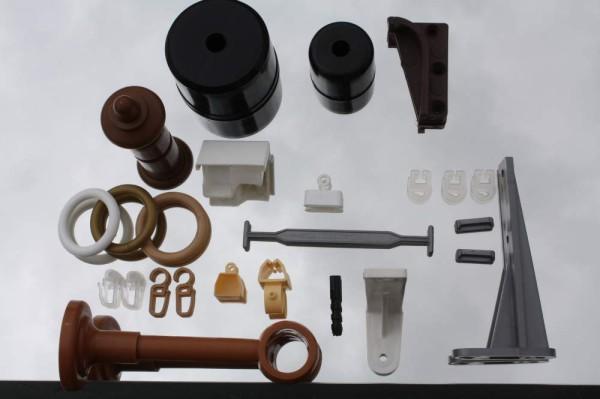 Фурнитура для карнизов для штор может выполняться из металла, пластика или дерева