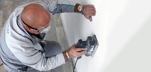 Обработка стены плоскошлифовальной машинкой